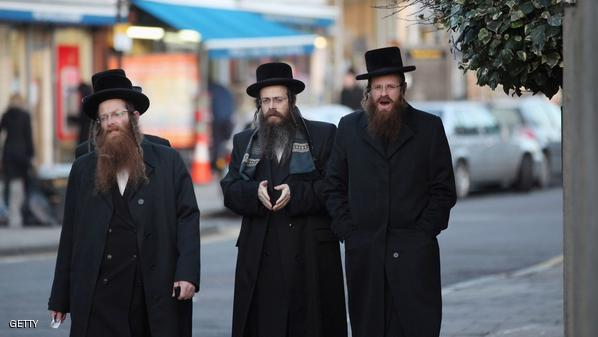LONDON, ENGLAND - JANUARY 19:  Jewish men walk along the street in the Stamford Hill area of north London on January 19, 2011 in London, England. The residents of Stamford Hill are predominately Hasidic Jewish and only New York has a larger community of Hasidic Jews outside Israel. The area contains approximately 50 synagogues and many shops cater specifically for the needs of Orthodox Jews.  (Photo by Oli Scarff/Getty Images)